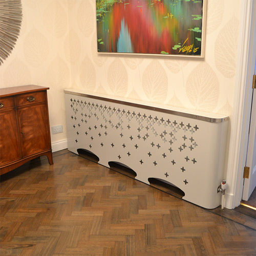 casa-fall-laser cut metal radiator-cover-in-beautiful-lobby-reception-area