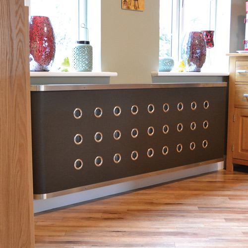 YOYO-Vinyl-soft-radiatpr-covers-in-Grey-Vinyl-with-stain-nickel-eyelets.jpg Radiator Cover
